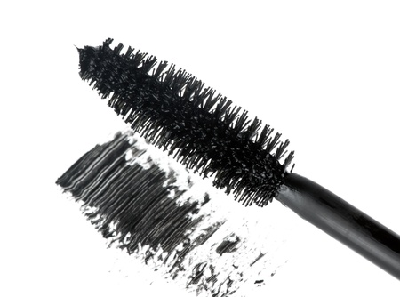Mascara brush on white background photo