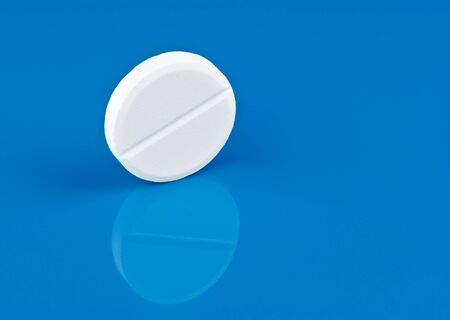 Pill on blue background photo