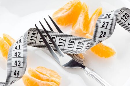 diet concept: Diet concept. Fresh fruits and measuring tape