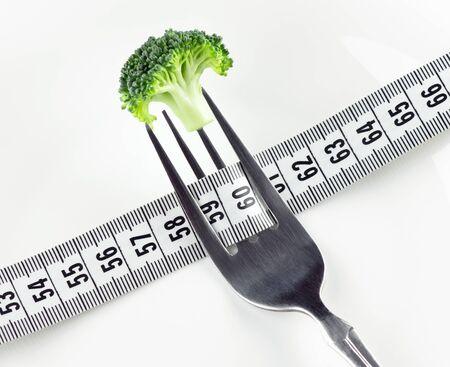 diet concept: Diet concept. Fresh broccoli on fork Stock Photo