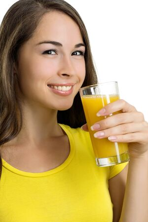 Portrait of young smiling beautiful woman drinking orange juice  photo