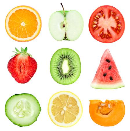 Collection of fresh fruit and vegetable slices on white background. Orange, kiwi, lemon, apple, strawberries, watermelon, cucumber, tomato and pumpkin photo