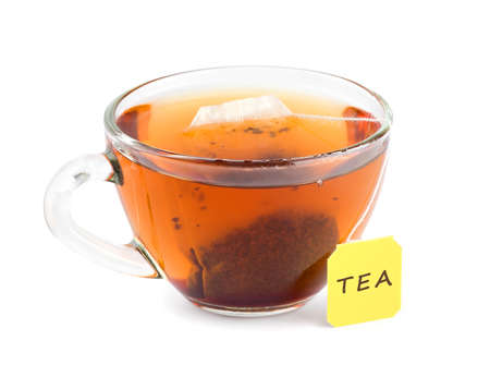 teabag: Cup of tea with teabag on white background