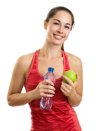 Healthy woman with apple and water smiling on white background photo