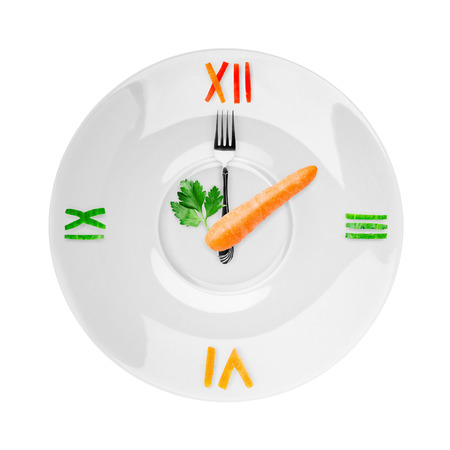 snack time: Food clock on white background. Healthy food concept