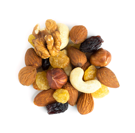 Healthy dried fruits and nuts on white background Stock Photo