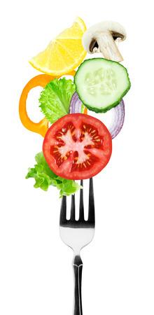 Fresh vegetables on fork. Healthy food Imagens