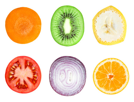 Collection of fresh fruit and vegetable slices on white background. Carrot, kiwi, banana, onion,  tomato and orange