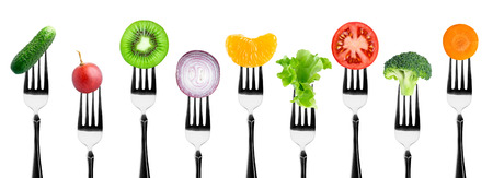 food on white: Fruits and vegetables on the forks. Healthy food