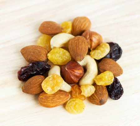 Healthy dried fruits and nuts closeup photo