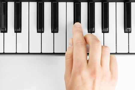 Hand playing on piano photo