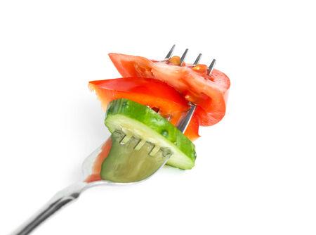diet concept: Fresh vegetables on fork on white background. Diet concept Stock Photo