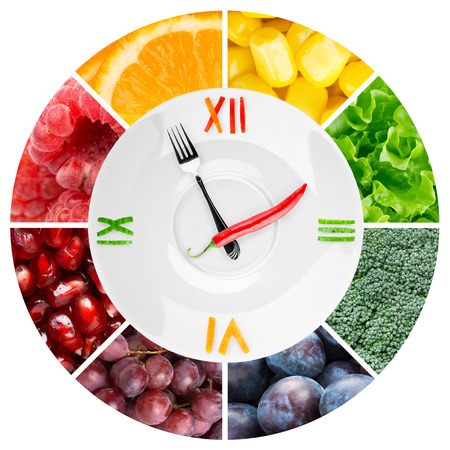 snack time: Food clock with vegetables and fruits. Healthy food concept Stock Photo