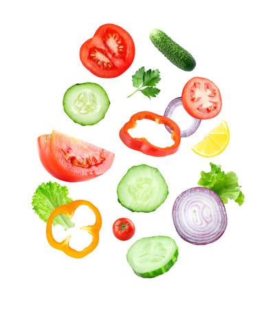cucumber slice: Falling fresh vegetable slices on white background