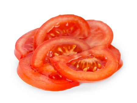 tomato slices: Fresh tomato slices on white background