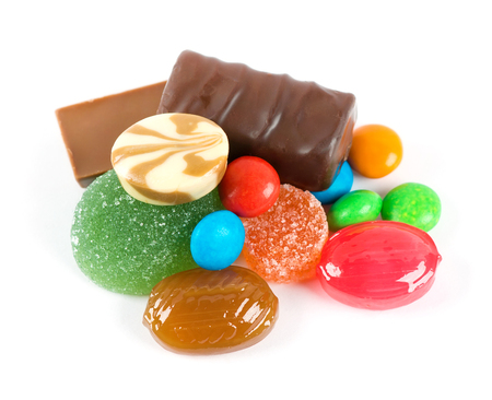 sweetmeats: Mixed colorful sweet candies on white background