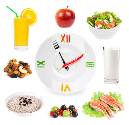 Clock with healthy diet food. Diet concept