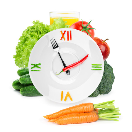 clock: Clock with healthy diet food. Diet concept