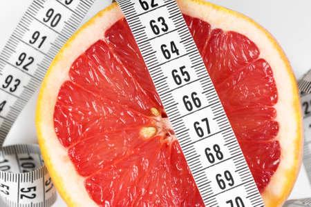 diet concept: Measuring tape with grapefruit. Diet concept
