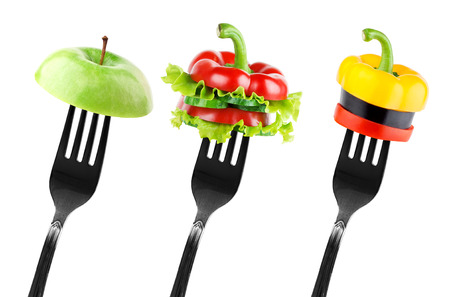 diet concept: Fruit and vegetable slices on fork. Diet concept Stock Photo