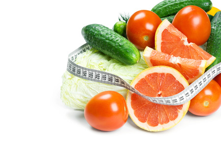 diet concept: Fresh fruits and vegetables on white background. Diet concept