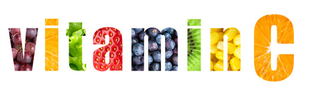 Vitamin C word on white background. Fresh fruits and vegetables Stock Photo
