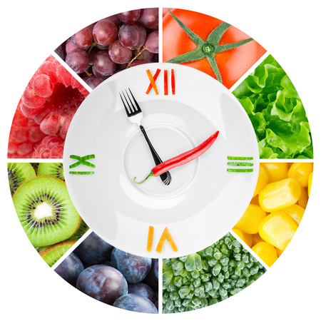 Food clock with vegetables and fruits. Healthy food concept 版權商用圖片