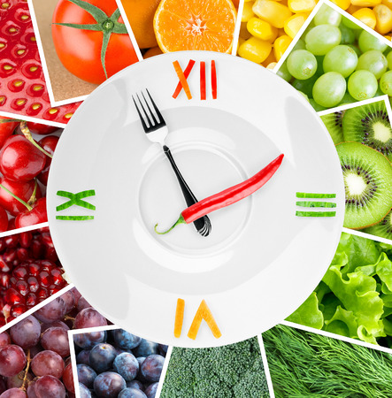 clocks: Food clock with vegetables and fruits. Healthy food concept Stock Photo