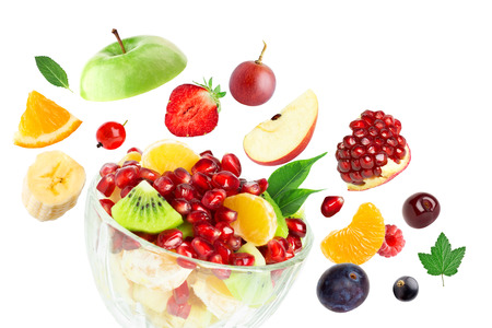 Fresh fruit salad on white background