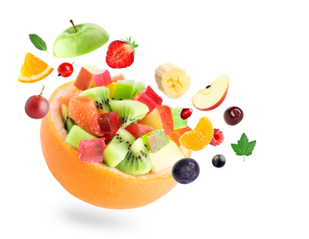 Healthy fruit salad on white background