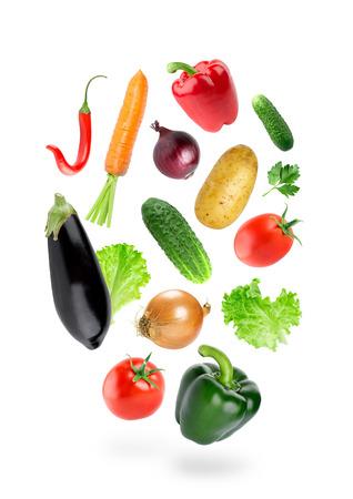 Falling fresh color vegetables on white background