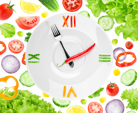 Food clock with vegetables. Healthy food concept