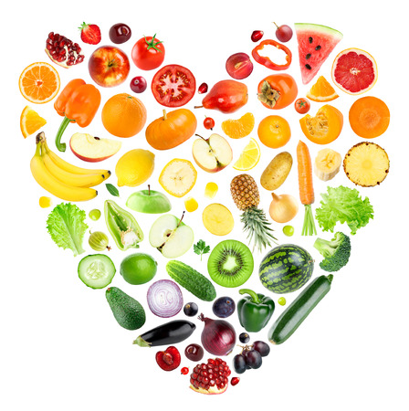 Rainbow heart of fruits and vegetables on white background. Fresh food Stockfoto