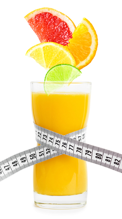 fruits juice: Fresh citrus juice and slices of fruit on white background. Diet concept Stock Photo