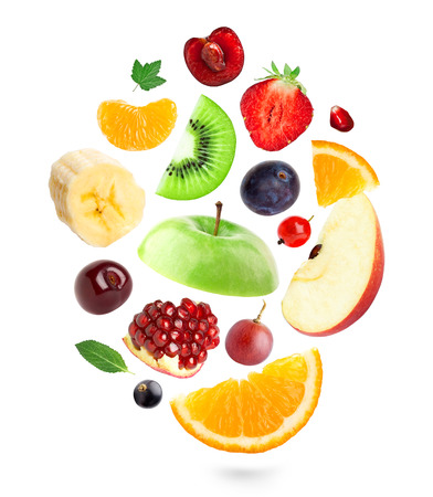 falling: Falling fresh fruits and berries on white background Stock Photo