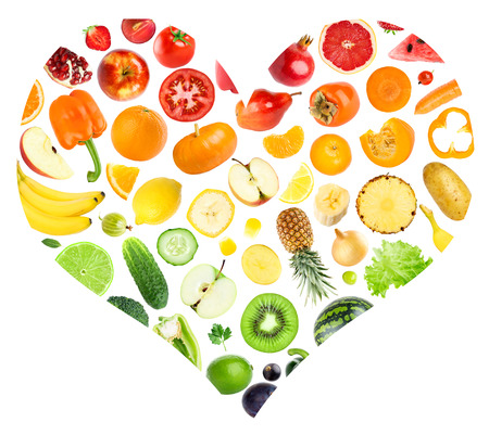 Rainbow heart of fruits and vegetables on white background. Food concept