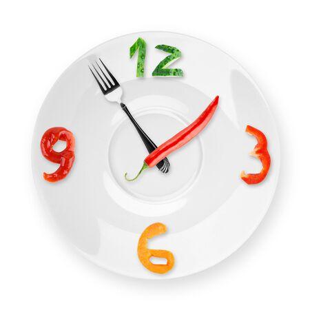 almuerzo: Reloj de Alimentos en el fondo blanco. Concepto de alimentos saludables