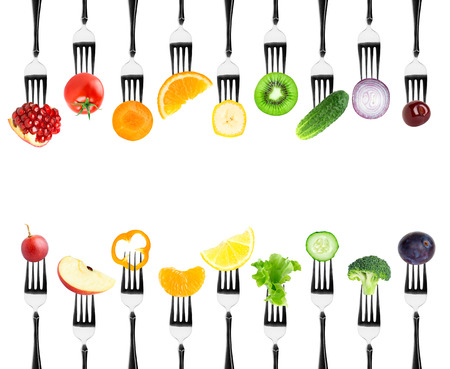 Color fruits and vegetables on fork on white background. Fresh food Archivio Fotografico
