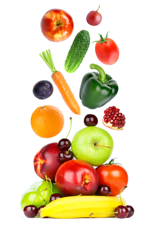 Fresh fruits and vegetables falling on white background Stockfoto