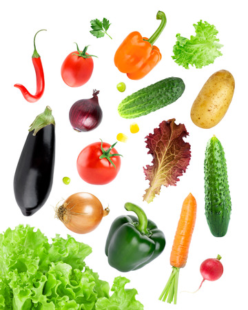 mixed vegetables: Falling fresh color vegetables on white background