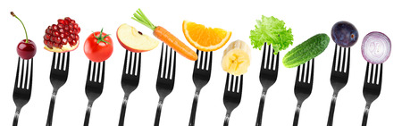 vegetables on white: Color fruits and vegetables on fork on white background. Fresh food Stock Photo