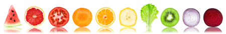 Collection of fresh fruit and vegetable slices on white background