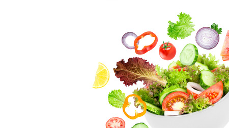 Fresh salad. Mixed falling vegetables in bowl on white background 免版税图像 - 49038691