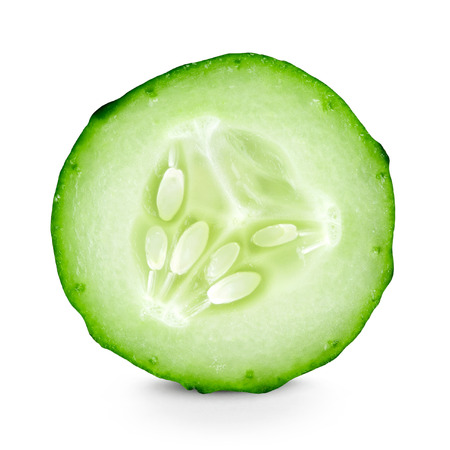 Cucumber slice closeup on white background Фото со стока