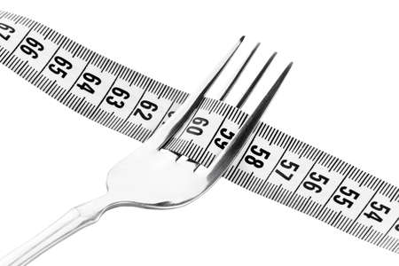 Diet concept. Fork and measuring tape on white background Stock Photo