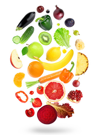 falling: Falling fresh color fruits and vegetables on white background Stock Photo