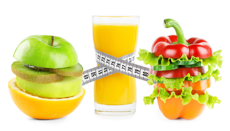 Juice with fruits and vegetables on white background. Diet concept