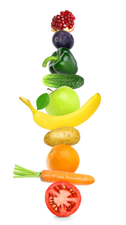 mixed fruits: Fruits and vegetables on white background. Healthy food concept. Stack of fresh food Stock Photo