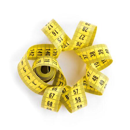 cintas: Cinta de medición en el fondo blanco. concepto de la dieta Foto de archivo