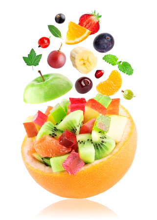 Fruits. Fruit salad in bowl on white background Stock Photo